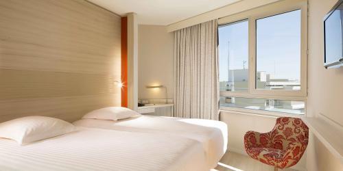 Chambre---Hotel-Oceania-Clermont-ferrand-4-etoiles-(17).jpg