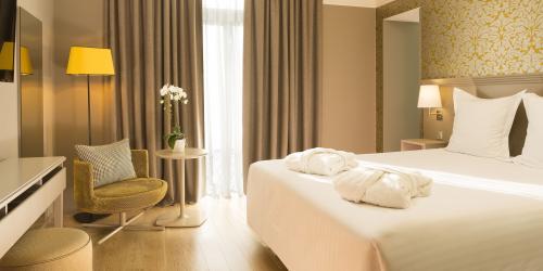 hotel-4-etoiles-dijon-oceania-le-jura-chambre-deluxe-double-avec-peignoirs.jpg