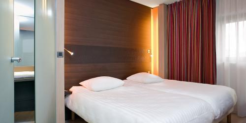 Chambre Superieure 2 lits simples -  Hotel Oceania Paris Porte de Versailles 4 étoiles.jpg