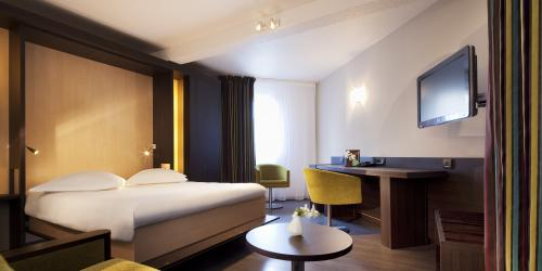 Hôtel Escale Oceania Vannes 3 étoiles - Chambre Prestige Double coin salon.jpg