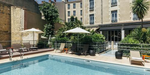 Hotel Oceania Le Metrople Montpellier - Hotel Spa 4 etoiles Montpellier - Piscine.jpg