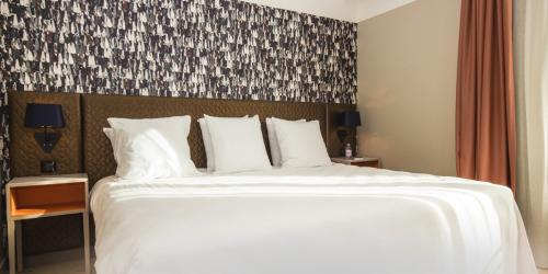 Oceania-Le-Metropole-Montpellier---4-etoiles---Chambre-Prestige-tete-de-lit.jpg